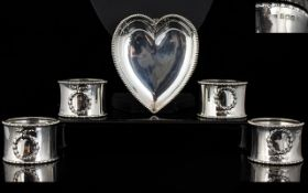 A Pleasing Set Of Four Solid Silver Napkin Holders From the early part part of the 20th century,