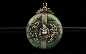 A Jadeite Stone Talisman Of circular form with applied white metal strapwork and floral Buddha