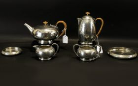 Liberty & Co Tudric Pewter Six-Piece Tea Service Planished finish with wicker wound handles,