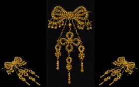 A 14ct Gold Victorian Ribbon Pendant Brooch Bow form filigree brooch,