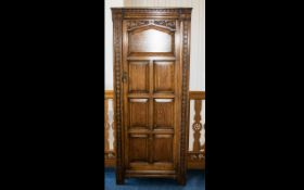 Oak Hall Cupboard - comprising top shelf to interior, panelled front with floral decoration to door.