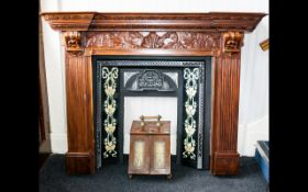 A Mahogany Fire Surround - of traditional form with reeded pillars and carved mantle detail,