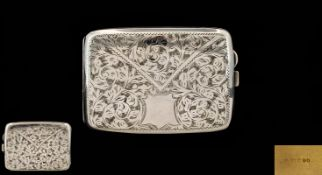 A Solid Silver Hinged Cigarette Case of Bowed Form with chased styalised floral decoration to front