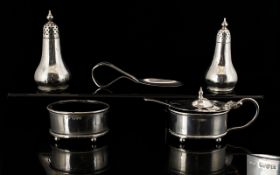 A Small Collection Of Silver Items Five pieces in total, to include caddy spoon, two Pepperettes,