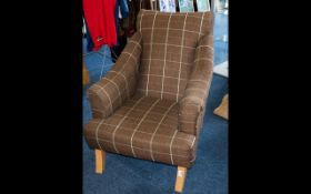 Schrieber Plaid Upholstered Armchair - modern, low chair in neutral tone windowpane check fabric.