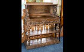 Oak Sideboard - ornately carved with central stretcher, two top drawers and barley twist legs.