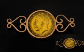 George V 22ct Gold Half Sovereign - Date 1915 London Mint, Within a 9ct Gold Mount. Total Weight 6.