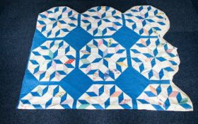 An Early 20th Century American Patchwork Quilt Hand stitched in polychrome printed patches and