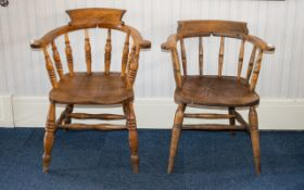 A Pair Of Windsor Style Chairs Each of traditional form with curved armrest and spindle back,
