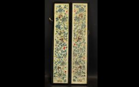 A Matched Pair Of Antique Chinese Silk Embroidered Cuff Panels Each framed and glazed, each on ivory