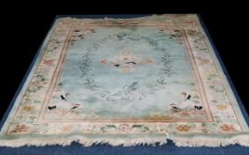 Oriental Style Wool Rug - rectangular carpet with cream border detail and Japanese crane design on