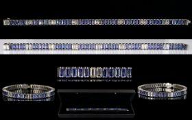 18ct White Gold Superb Emerald Cut Diamond & Tanzanite Link Bracelet.