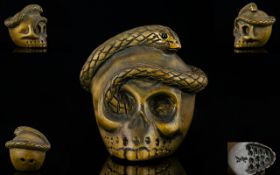Japanese 19th Century Signed Boxwood Netsuke in the form of a Human Skull with entwined snake