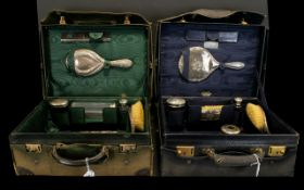 Two Antique Travel Vanity Cases Each lined in green silk moire, each leather bound with impressed A.