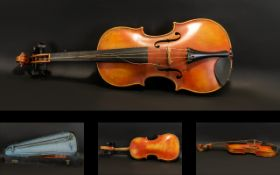 A Late 19th Early 20th Century Violin One piece back, along with bow and fitted case,