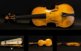 A Late 19th Early 20th Century Violin Two piece back, along with bow and fitted case,