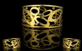 18ct Gold And Diamond Set Italian Designer Cuff Of Abstract Design set with six collet set diamonds