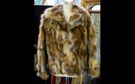 Fox Fur Ladies Short Jacket fully lined in polysatin with floral decoration. With hook and eye
