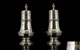 Edwardian Period and Nice Quality Pair of Silver Pepperettes of pleasing form.