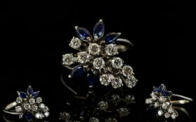 18ct White Gold Flower Head Design Diamond and Sapphire Dress Ring of Very Pleasing Appearance.