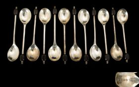 A Fine Boxed Set of Twelve ( 12 ) Solid Silver Coffee Spoons. Maker E.