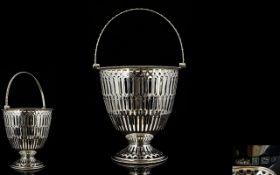 Art Deco Period Silver Swing Handle Sugar Basket with Elaborate Open worked Body of Tapered Form.
