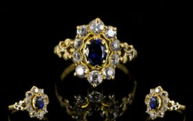 18ct Gold Sapphire And Diamond Cluster Ring The central blue sapphire surrounded by round cut