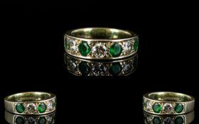 Ladies 9ct White Gold Attractive 7 Stone Emerald and Diamond Ring. The 3 Round Brilliant Cut