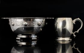 Two Pieces Of Silver Plated Ware To include twin handle quaich raised on four scroll feet, the