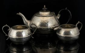 Three Piece Planished Pewter Tea Service Each with central faux riveted band, marked to base '