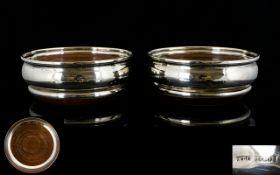 Elizabeth II Fine Pair of Silver Coasters of Circular Form with Oak Bases.