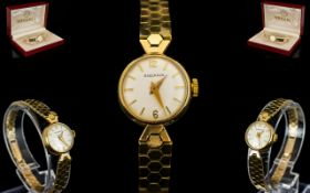 Rodania Ladies Mechanical 9ct Gold Bracelet Watch. Both case and bracelet marked for 9ct. 16.