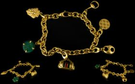 Gucci 18ct Yellow Gold Charm Bracelet Comprising six charms to include horsebit, enamel bag,
