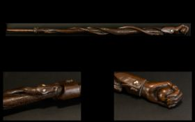 Indonesian Hardwood Carved Walking Stick The top carved in the form of a clenched hand,