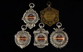 A Collection Of Four Silver And One Brass Medals/Fobs Issued By N.C.C.C Barnoldswick section clarion