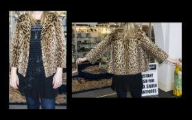 1960's Ocelot Jacket Hip length jacket with side seam pockets, revere collar and oversized faux