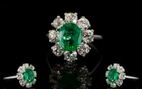 18ct White Gold Diamond Emerald And Diamond Cluster Ring Set with oval cut Emerald surrounded by 8