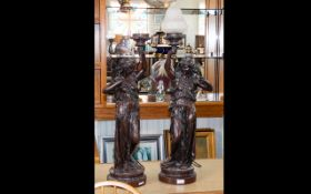 A Pair Of Large Heavy Bronzed Figural Lamps In 19th Century French Style each in the form of