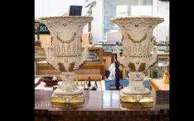 P Weldon A Pair of Staffordshire Cream Glazed Campana Urns - floor standing,