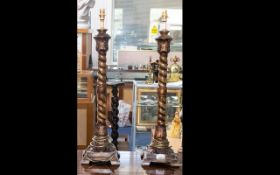 A Pair Of Reproduction Table Lamp Bases each raised on square base with barley twist column and