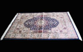 A Large Woven Silk Carpet Keshan rug with blue ground and traditional Middle Eastern floral and