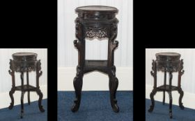 A Chinese Wooden Jardiniere Stand - of circular form with carved, pierced floral decoration,