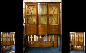 Edwardian Bow Fronted Display Cabinet, with astral glazed doors and inlaid decoration. Raised on