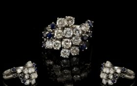 18ct White Gold Attractive Diamond And Sapphire Set Cluster Ring flower head design diamonds and