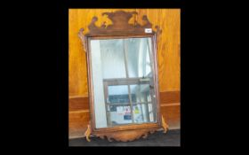 Two Antique Mahogany Framed Mirrors Each of rectangular form with shaped frame to top and bottom.
