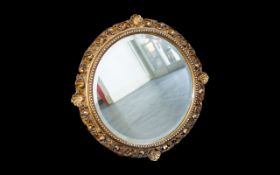 A Late 19th/Early 20th Century Circular Mirror Bevelled Glass Mirror Housed In Ornate Gilt Geso