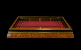 A Birds Eye Maple Finish Tabletop Display Rectangular glazed and hinged display case with gilt trim,