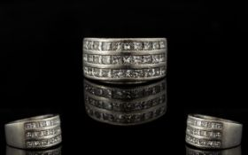 Platinum And Diamond Set Superb And Attractive Contemporary Ring Comprising three rows of ten