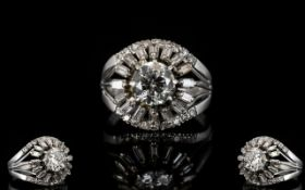 18ct White Gold And Diamond Cluster Ring Set with a central round brilliant cut diamond of approx 1.