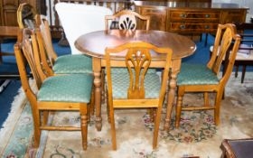 Pine Kitchen Table & Five Chairs. Extending table of oval form with 5 matching chairs, each